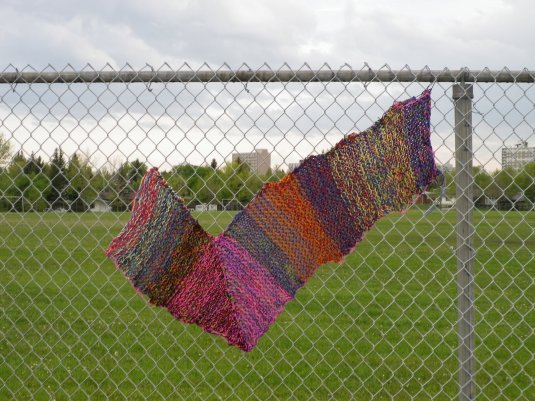 Check Mark yarn bomb on school fence